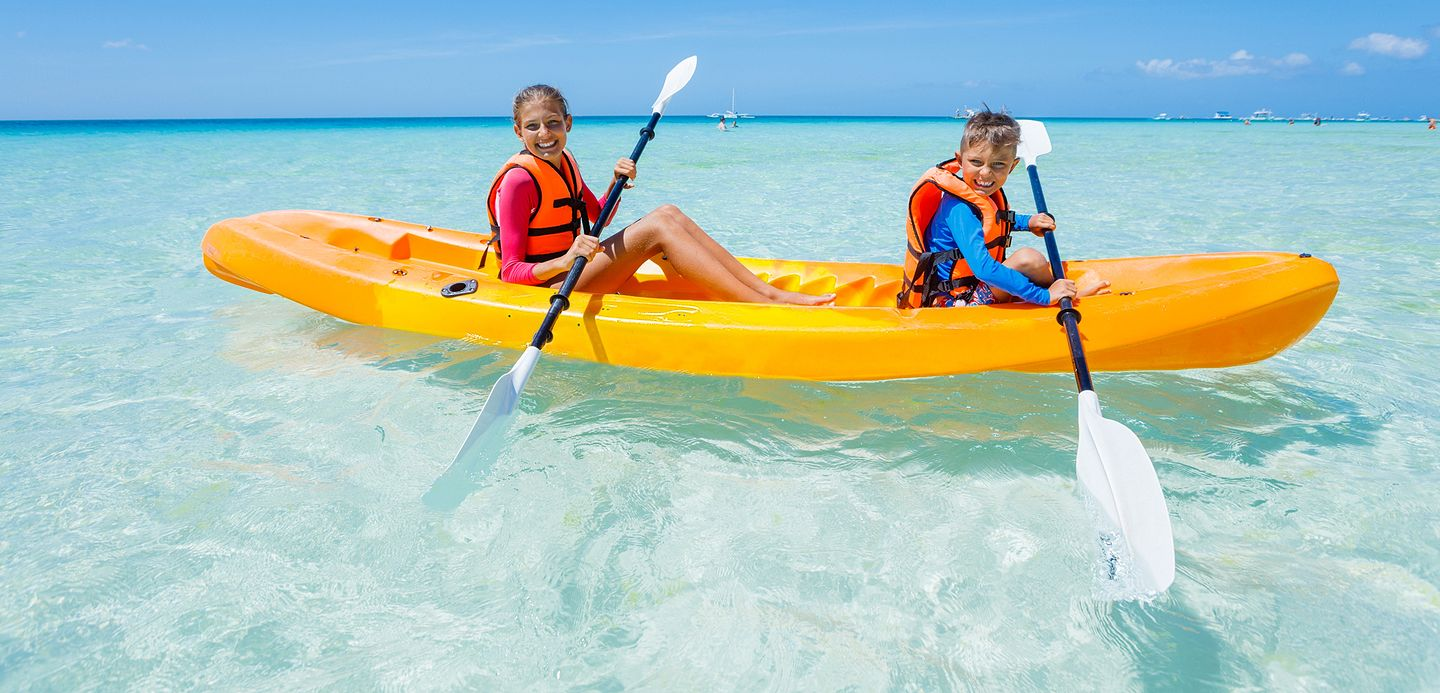 two kids in a kayak